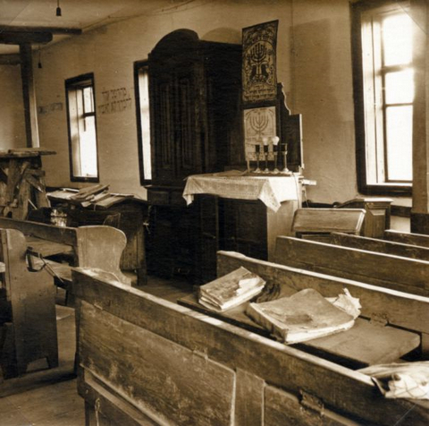 Ark, pews, lecterns, and prayer books in Bershad synagogue