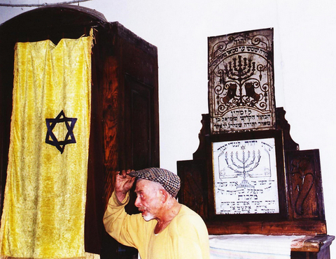 Beadle near ark and cabinet in Bershad synagogue