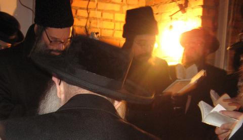 visitors davening in ohel of R Pinchas